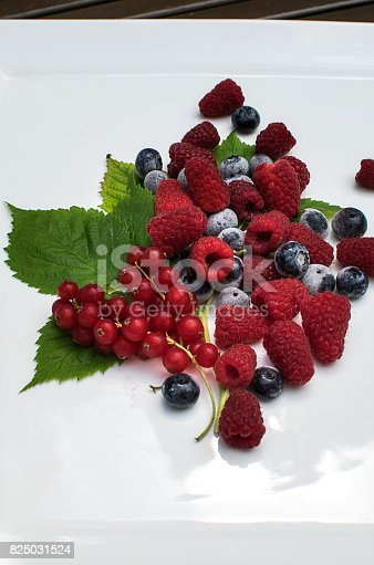 istock Vertical shot on mixed berries on white 825031524