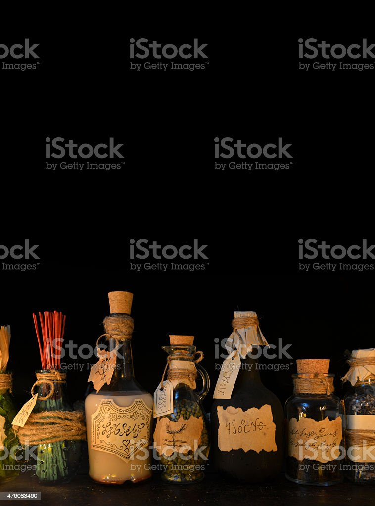 Vertical still life with witch bottles and copy space stock photo