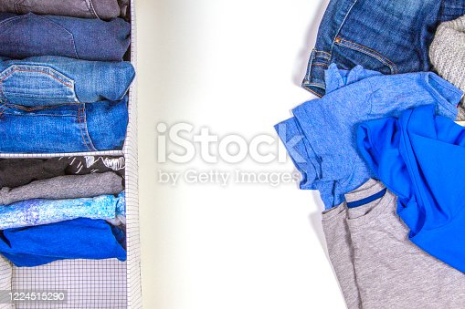 1146468292 istock photo Vertical storage of clothing, tidying up, room cleaning concept. Stack of folded clothes in basket with heap unholded clothes on white background 1224515290