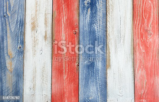 istock Vertical stressed boards painted in USA national colors 518726782