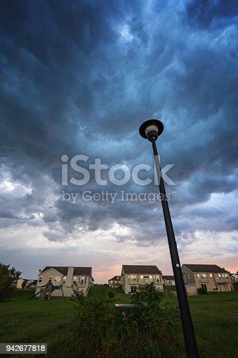 516351793 istock photo Vertical Summer Storm over a Neighborhood 942677818