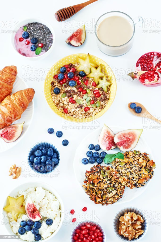 Vertical top view of healthy breakfast on a white table. stock photo