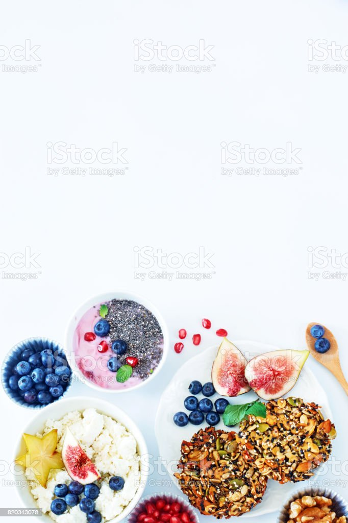 Vertical top view of healthy breakfast on a white table with a copy space. stock photo