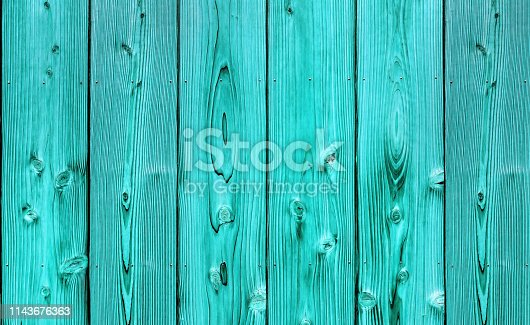 Close up shot of vertical turquoise fence wood panel texture