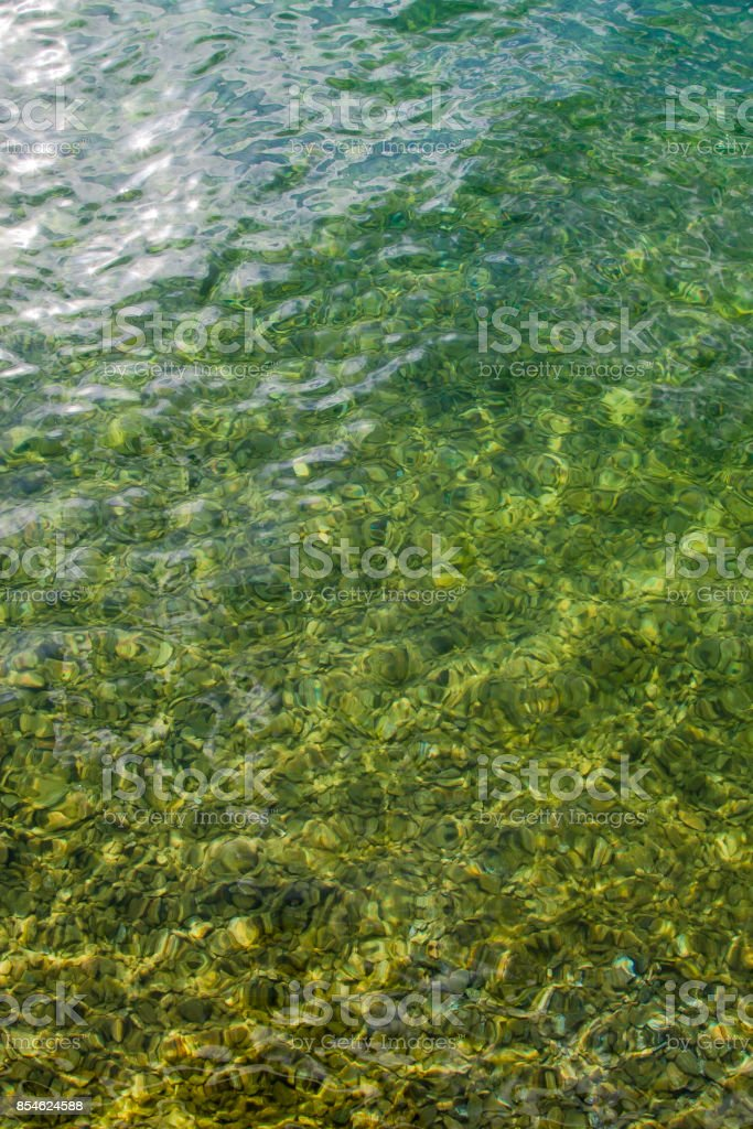 Vertical up view of crystal transparent fresh river sea water stock photo