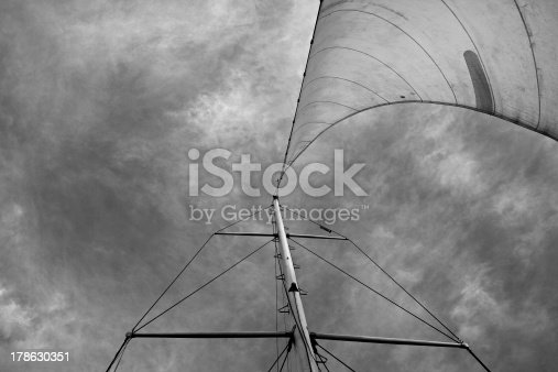 501889762istockphoto Vertical upwards view of a yacht mast and sail 178630351