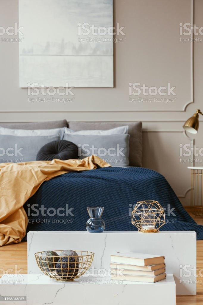 Vertical View Of Elegant Blue Grey Gold And Orange Bedroom ...