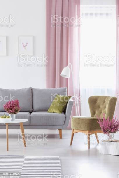 Vertical view of elegant living room with grey comfortable couch picture id1051728526?b=1&k=6&m=1051728526&s=612x612&h=pze97 mel 7g0tfh6avcomi93ey0c4fpljbaywvkngg=