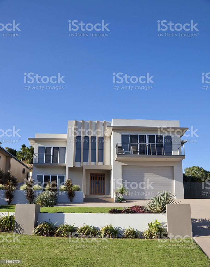 Vertical view of modern home and yard stock photo