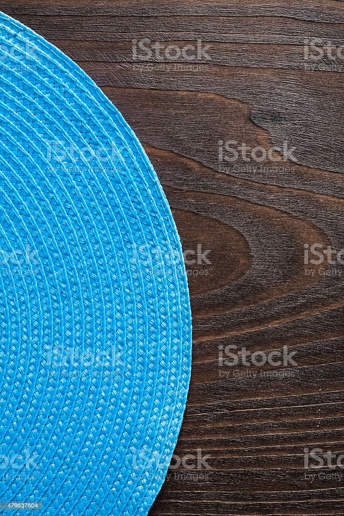 vertical view wickered round mat on vintage wooden board stock photo