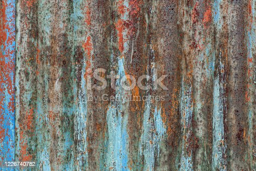 Vertical wavy pattern on corrugated metal sheet texture.