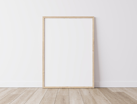 Vertical wooden frame Standing on parquet floor with white background, minimal frame mock up interior, 3d render