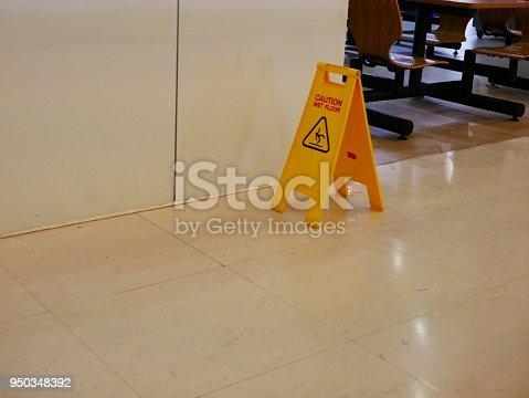 istock Vertical yellow wet floor caution sign 950348392