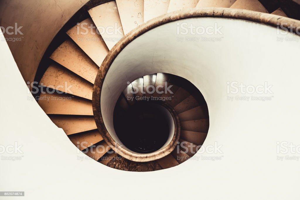 Vertigo concept spiral staircase view stock photo