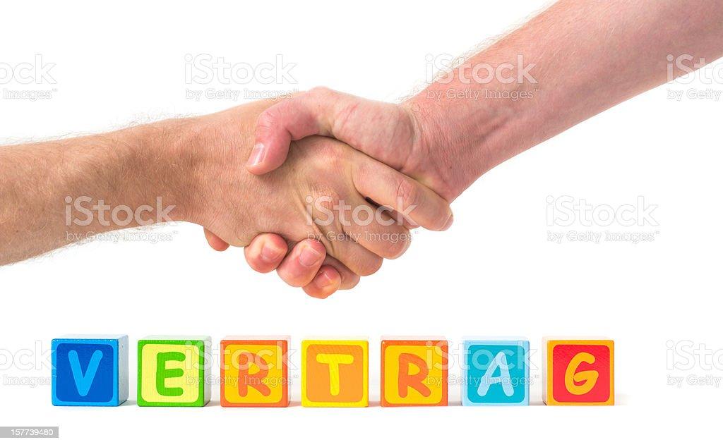 Vertrag with handshake stock photo