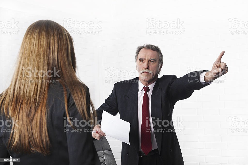Very angry manager firing one of his young employees royalty-free stock photo
