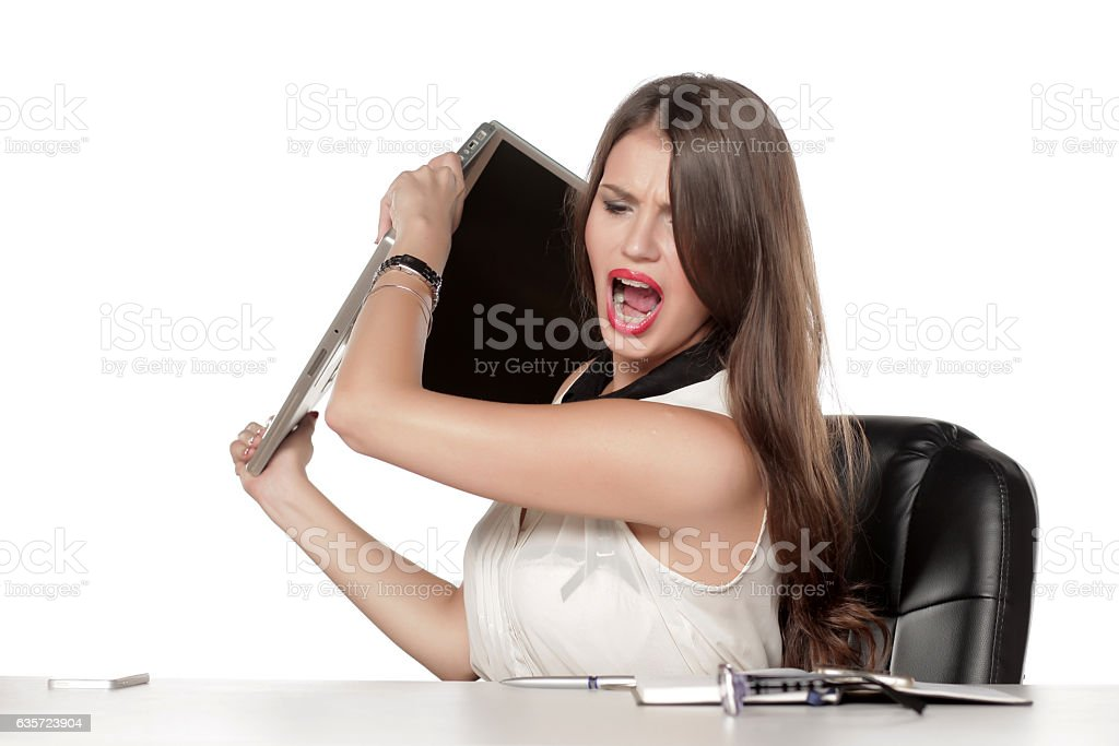 very angry young business woman with a laptop stock photo