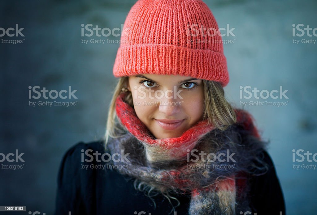 Very attractive girl wearing a hat and scarf royalty-free stock photo