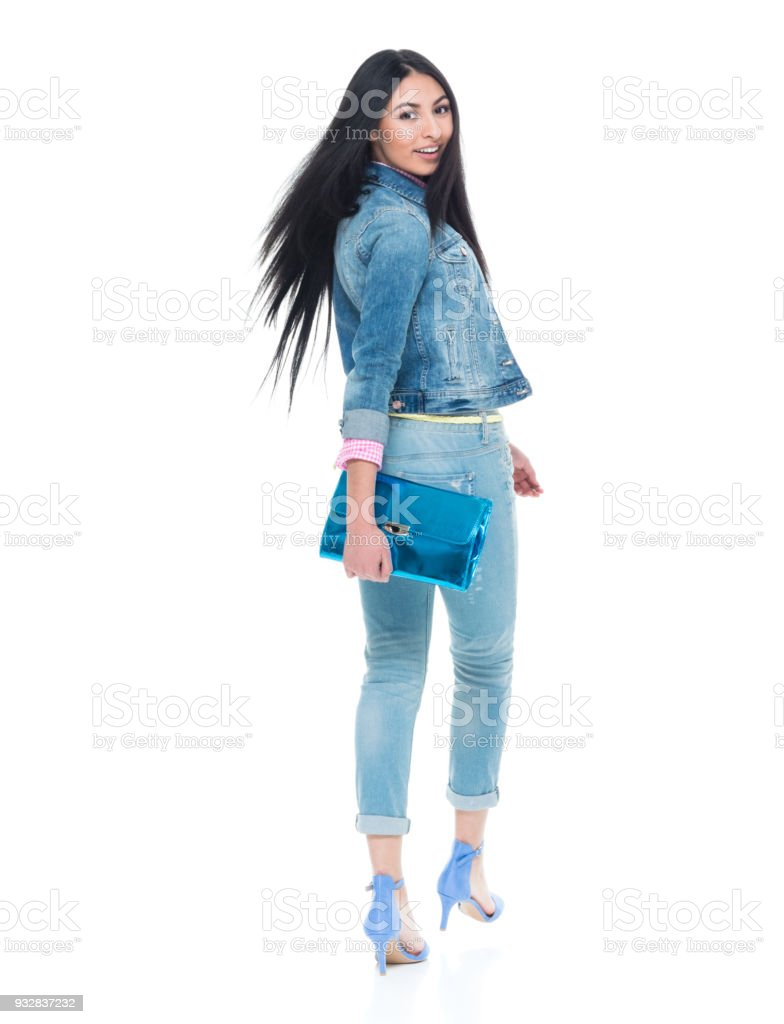 Very attractive young latino lady walking and turning around stock photo