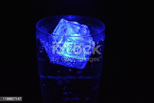istock Very beautiful and stunning images of drinks with glowing ice cubes.  Bright colors with bubbles in a glass of champagne.  Promotional image of a relaxing, dear life and a tasty sparkling drink. 1159627147