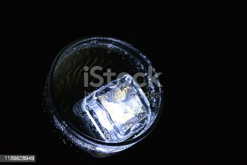 istock Very beautiful and stunning images of drinks with glowing ice cubes.  Bright colors with bubbles in a glass of champagne.  Promotional image of a relaxing, dear life and a tasty sparkling drink. 1159628949