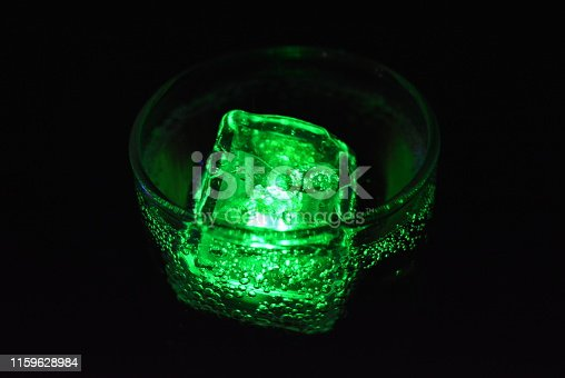 istock Very beautiful and stunning images of drinks with glowing ice cubes.  Bright colors with bubbles in a glass of champagne.  Promotional image of a relaxing, dear life and a tasty sparkling drink. 1159628984