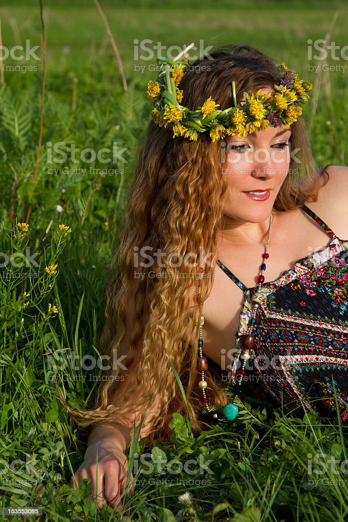 very beautiful girl in the wreaths of flowers royalty-free stock photo