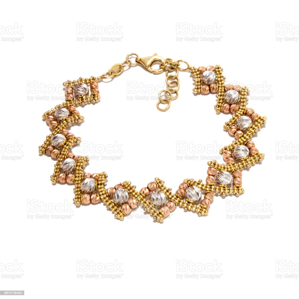 Very beautiful unusual golden bracelet from white, yellow and red gold stock photo