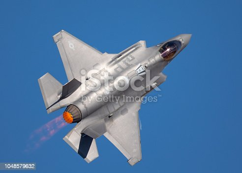 1145066973 istock photo Very close top view of an F-35 Lightning II  with afterburner on 1048579632