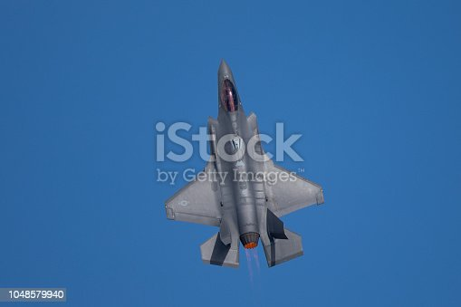 1145066973 istock photo Very close top view of an F-35 Lightning II  with afterburner on 1048579940