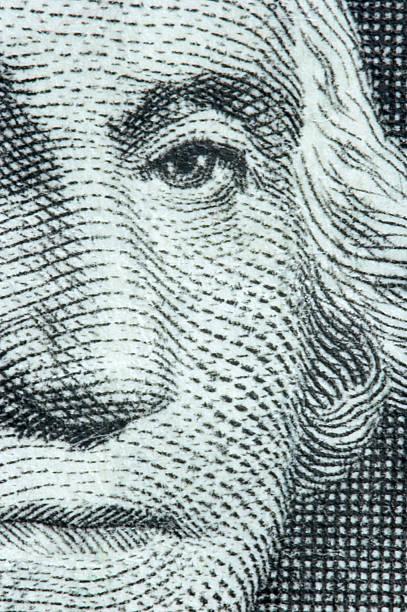 Very close-up image of George Washington on a dollar bill stock photo