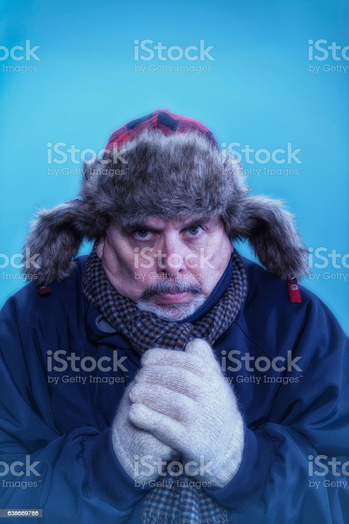Very cold adult Caucasian male looking at camera stock photo