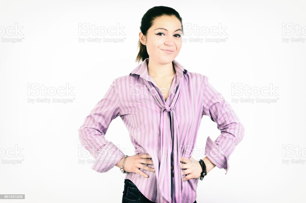 Very confident  young woman standing with hands on hips stock photo
