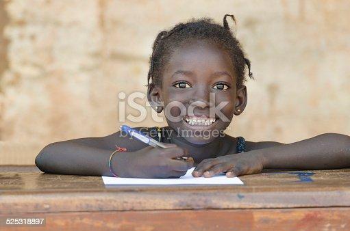911029592 istock photo Very Cute African School Girl Toothy Smile in Bamako, Mali 525318897