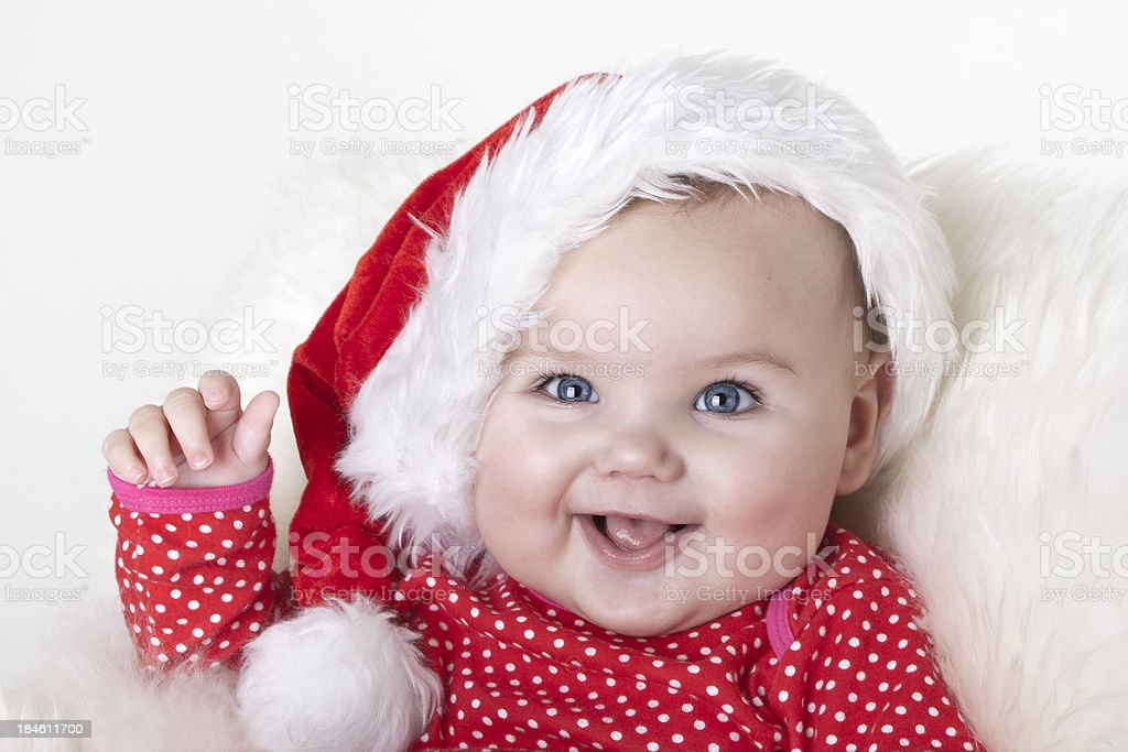 Very Cute Baby Girl With Blue Eyes Wearing Santa Hat Stock Photo
