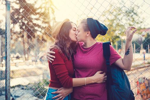 Very Cute Lesbian Couple Kissing Outside Stock Photo