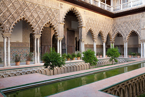 Very detailed Patio de las Doncellas, Real Alcazar, Seville One of the most beautiful landmarks in Real Alcazar Palace in Seville, Spain alcazar palace stock pictures, royalty-free photos & images