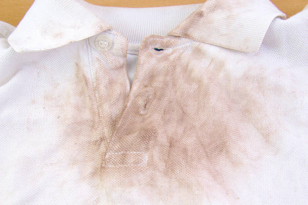 Very dirty white shirt Very dirty white shirt wet clothing women t shirt stock pictures, royalty-free photos & images