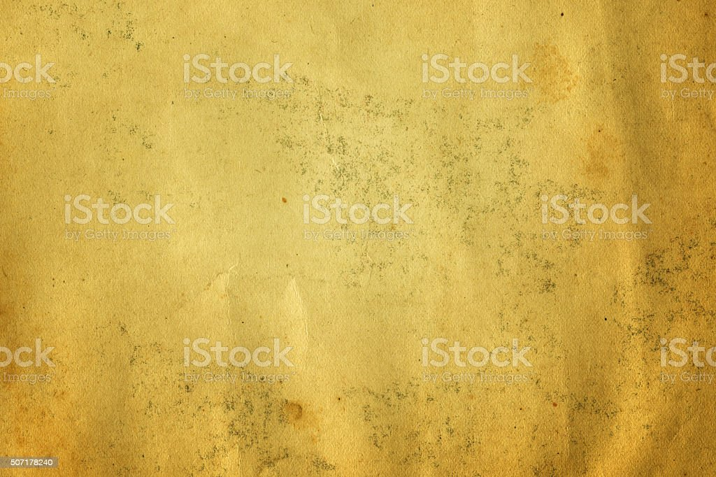 Very distressed light brown paper with water stain stock photo