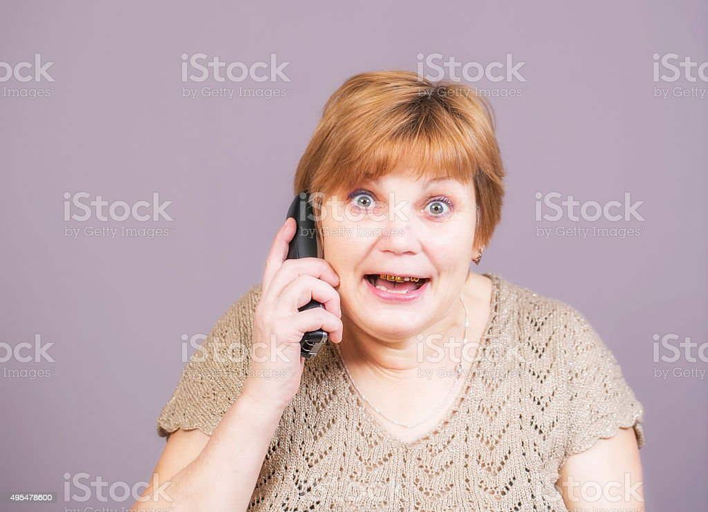 Very emotional angry woman with gold teeth stock photo