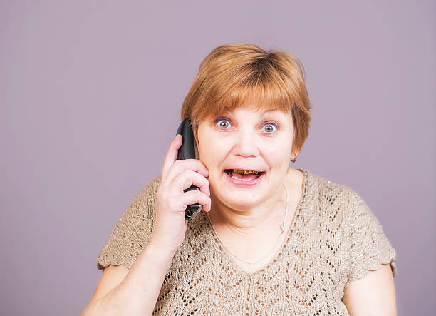very emotional angry woman with gold teeth - gold tooth stock photos and pictures