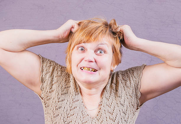 very emotional angry woman with gold teeth. - gold tooth stock photos and pictures