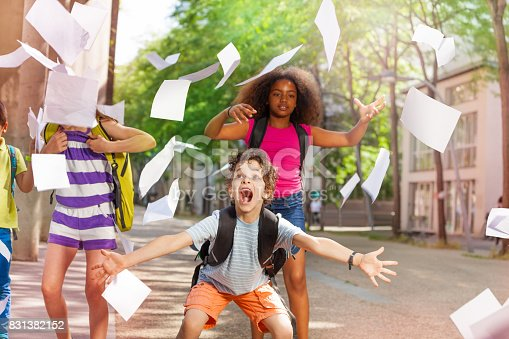 1176772377 istock photo Very excited boy scream with friends throws paper 831382152