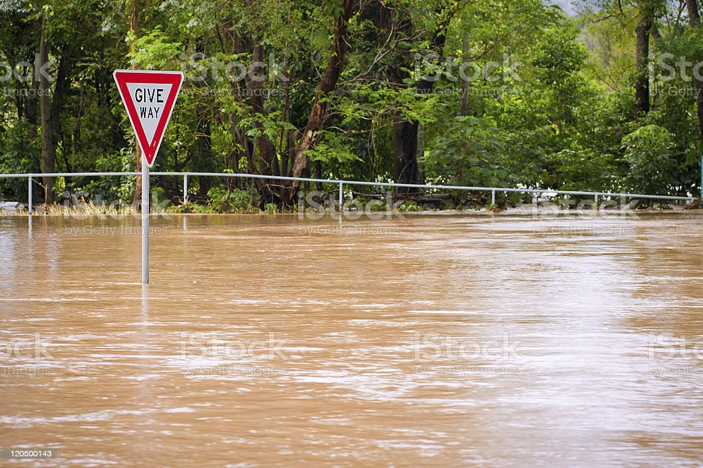 Very flooded road and give way sign royalty-free stock photo