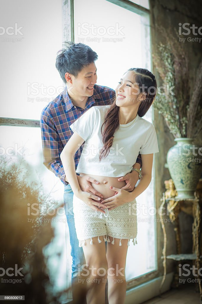 Very happy beautiful young man and woman Pregnant Belly. royaltyfri bildbanksbilder