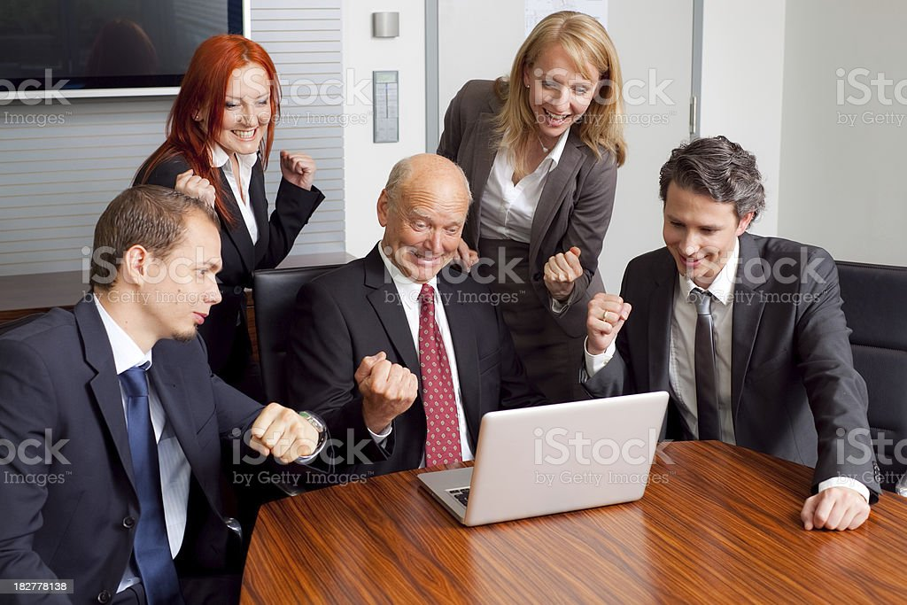 very happy business team rejoicing royalty-free stock photo