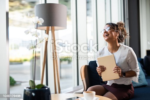 912944158istockphoto Very happy businesswoman. 1046129498