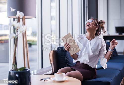 912944158istockphoto Very happy businesswoman. 1135930562