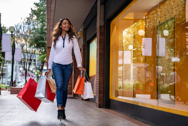 very happy woman shopping at the mall - spending money stock pictures, royalty-free photos & images