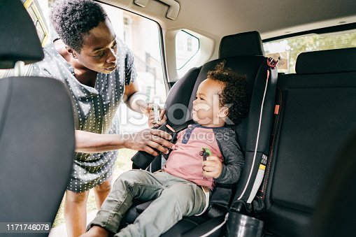 Mother and son sitting in a car